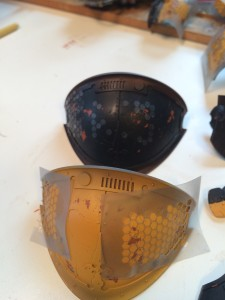 Masking on shoulder armor plates.