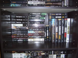 A bookshelf with Warhammer novels