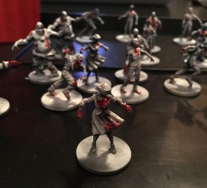 Black and white Zombicide walker with blood