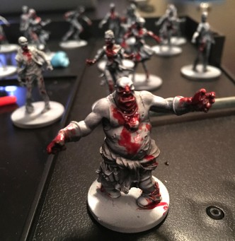 Black and white Zombicide fatty with blood
